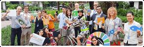 Sustainability - image of people holding up signs promoting sustainability