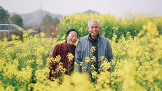 Man and Woman in a field of yellow flowers